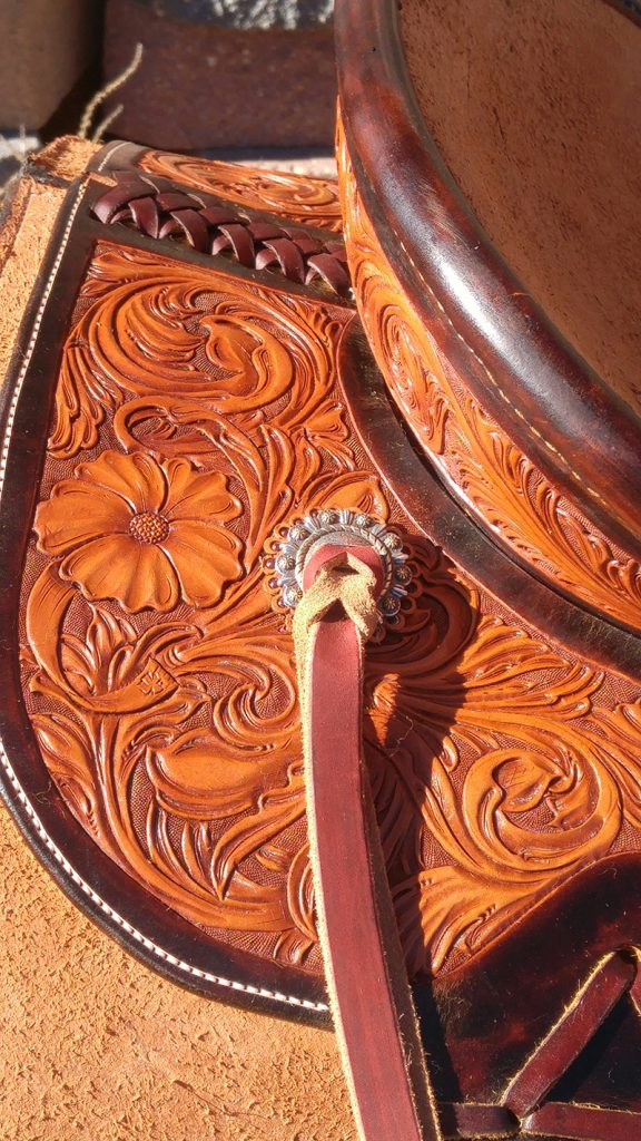 saddle tooled with a poppy flower