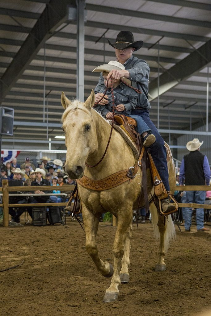 father and son riding palomino horse at Western Heritage Classic sale