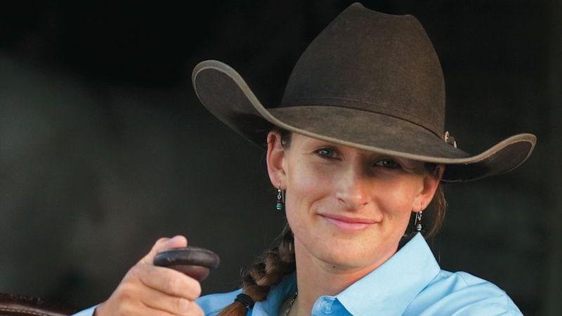 Kate Neubert leaning on saddle