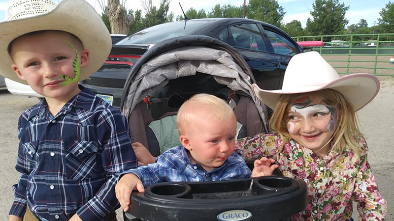 Kids with their face painted at the rodeo