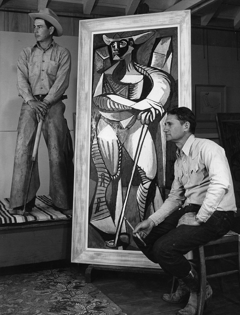 Peake in his studio with a cowboy model