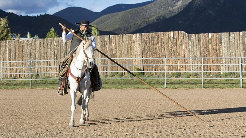 Rudy Lara rides with a garrocha