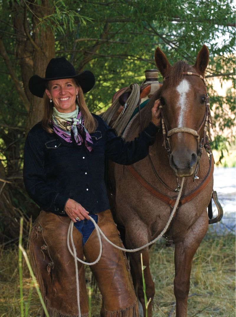 Liza Jane standing with red roan horse