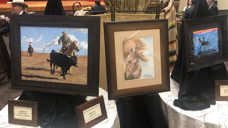 Winning art pieces of the 2019 Western Horseman youth art contest on display at the CA sale.