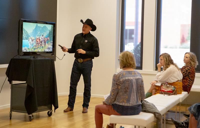 Cowboy artist Jason Rich gives a presentation at the CA Sale