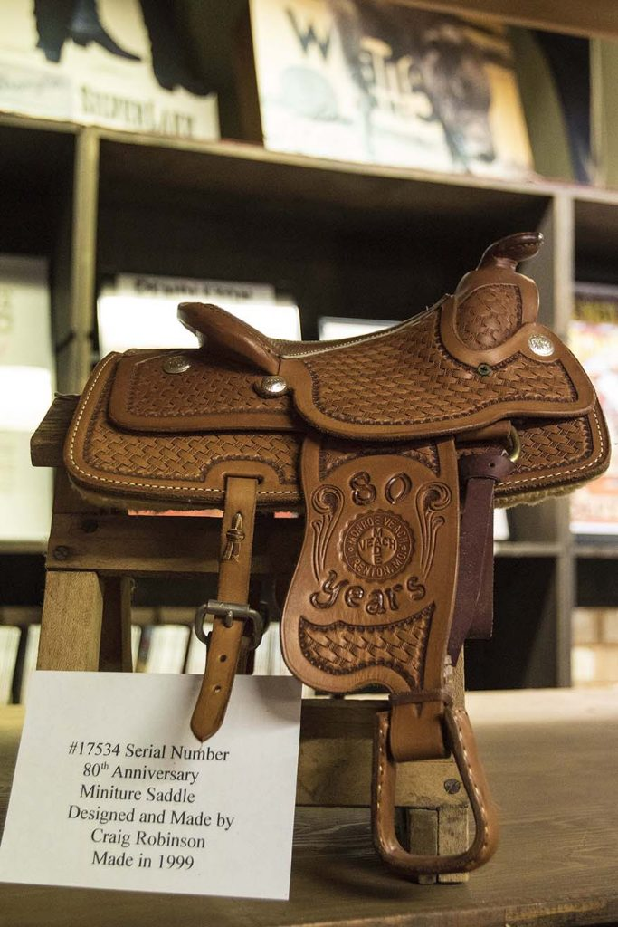 Craig Robinson made a miniature saddle for the 80th anniversary of Veach Saddlery
