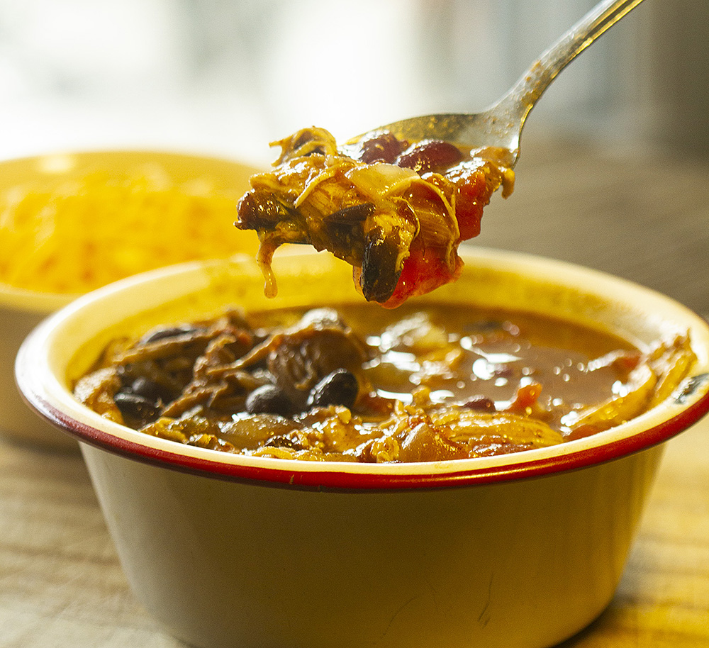 Warm up with chuckwagon cook Kent Rollins' slow cooker chicken chili recipe.