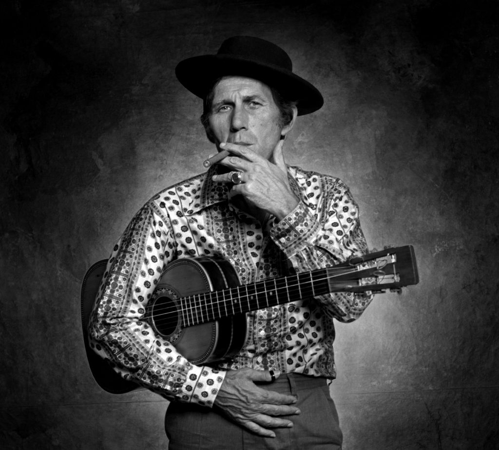 Chet Atkins stands for a portrait in Jim McGuire's studio.