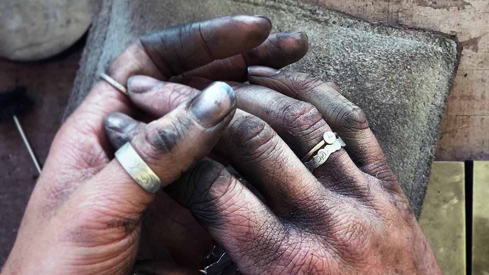 The hands of a craftsman reflect hours and years of hardwork making cowboy crafts.
