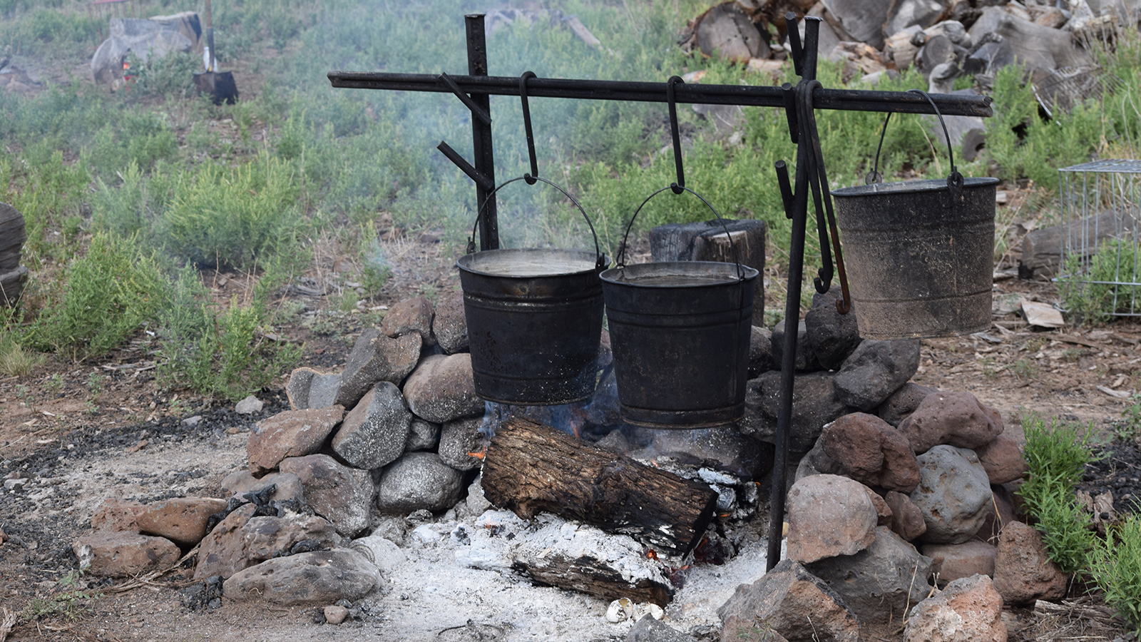 Jolyn Young prepares to cook at camp while her husbands catches wild cows.