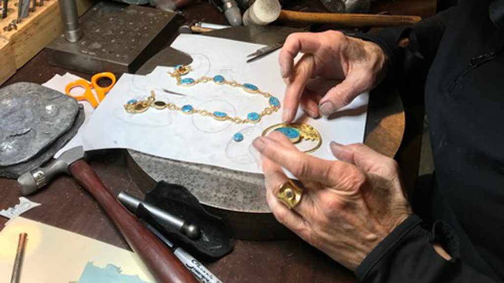 Victoria Adams makes jewelry in her Northern California shop