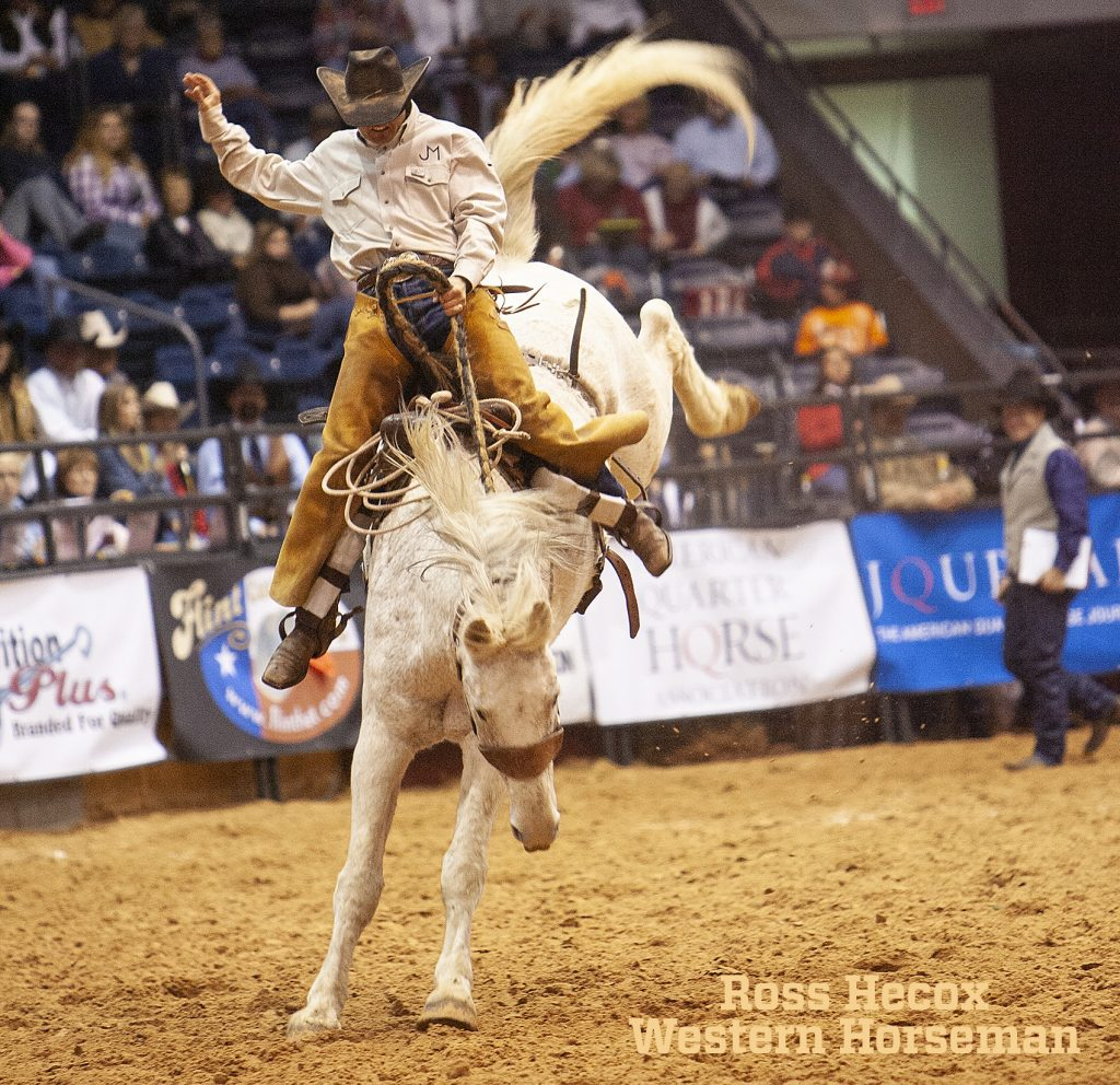 Stonney Jones rides a ranch bronc