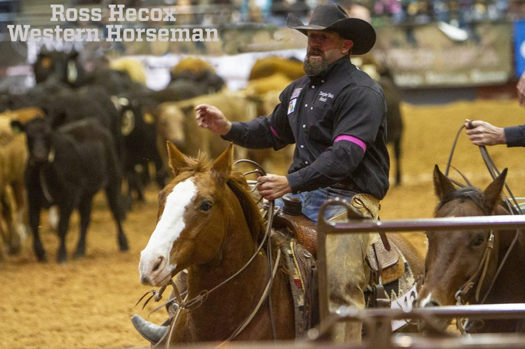 Buster Frierson competes in the team penning