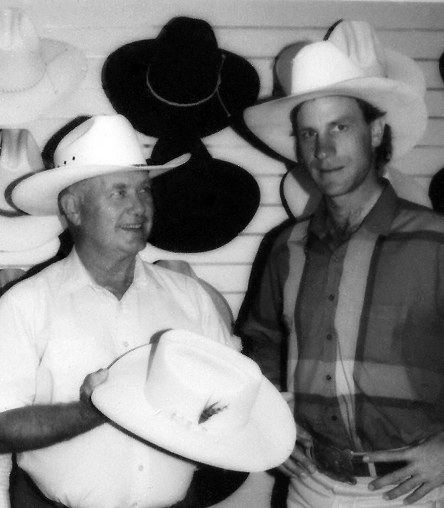 Chuck Bailey presents hat to Buck Brannaman