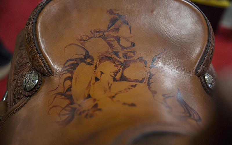 Josey Butler painted a bronc rider on the saddle