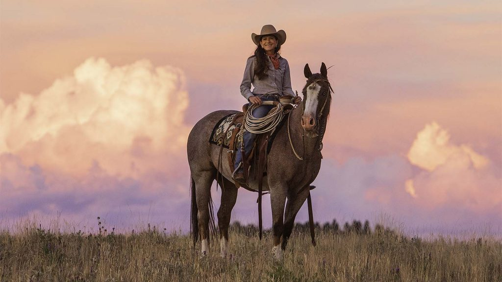 Cowgirl Tammy Pate rides her horse on the ranch.
