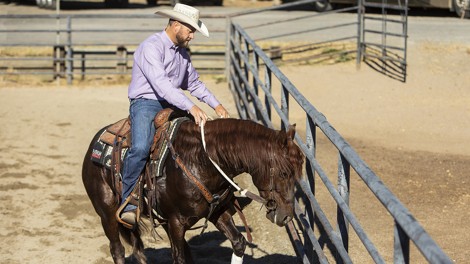 Clayton Edsall demonstrating how to use a fence to get a horse to stop and roll back