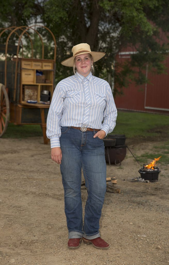 Jessica Casteel cooks from a chuckwagon.