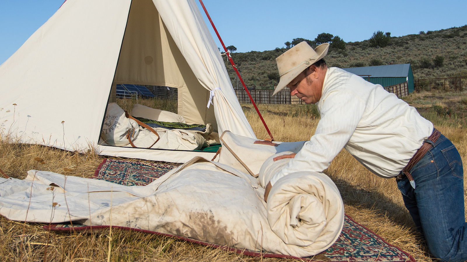 Rolling up a bedroll