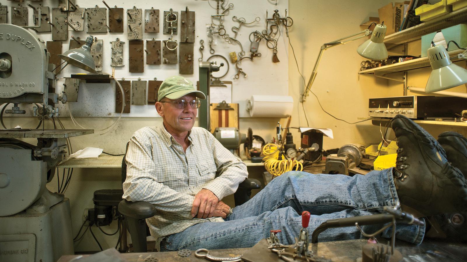 Tom Balding sits in his workshop