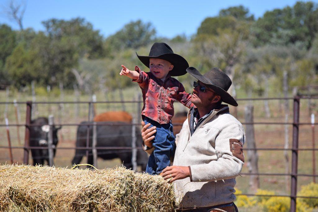 ranch kid on hay