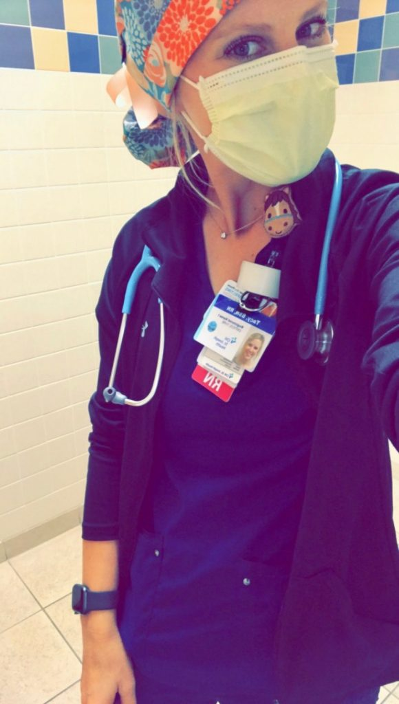 Tacy Kay working as an ICU nurse.