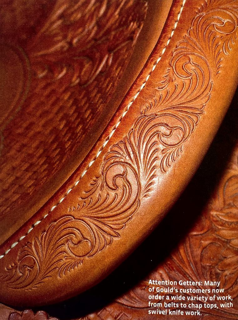 Detailed photo of swivel knife design work on a saddle cantle.