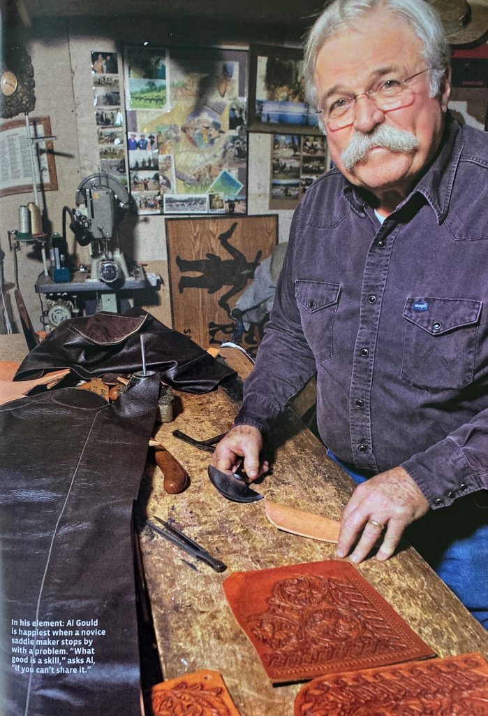 Gould works in his leather shop.