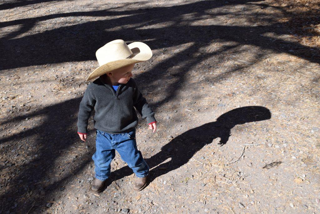 Little cowboy Levi Young wears Western wear every day.